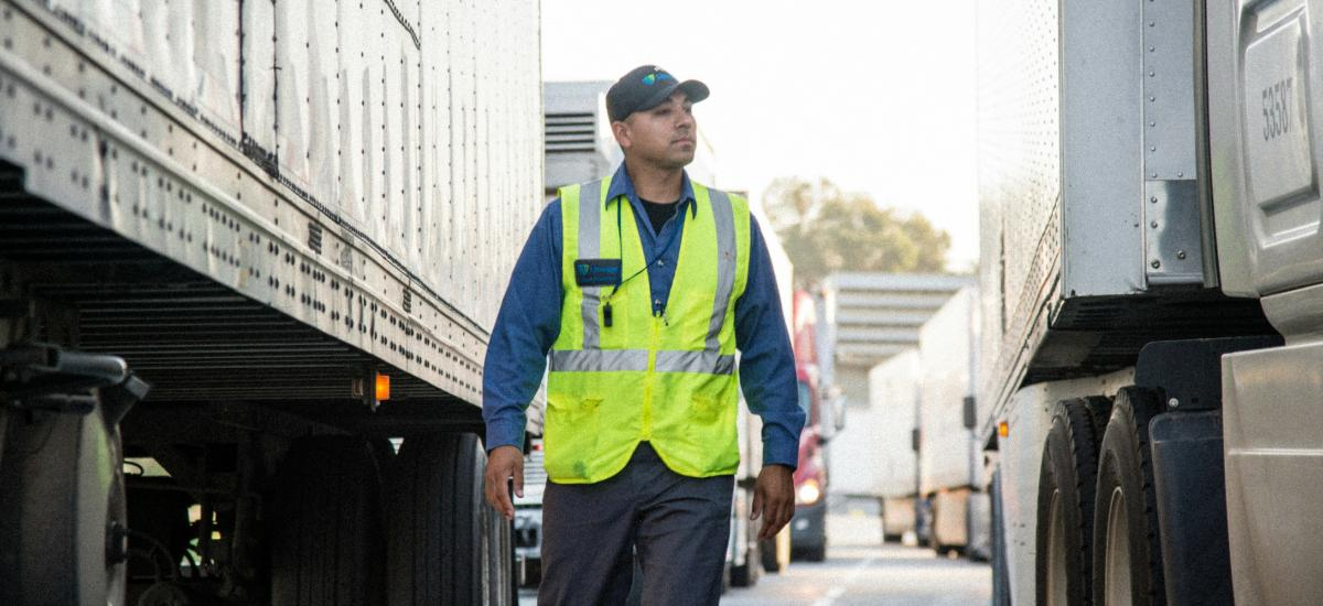 Man walking between trailers on the yard at Lineage