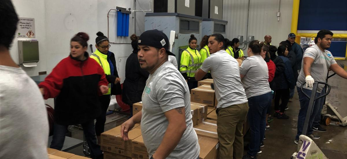 Team members working together at Feeding America affiliate food bank