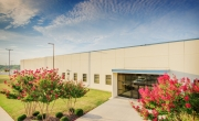 Photo of main entrance to Decatur, AL facility with flowers in bloom