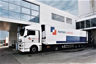 partner logistics truck outside of office building